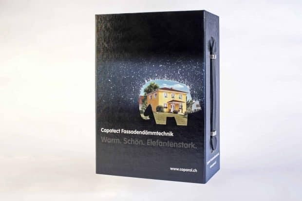 Maleta de presentación de cartón compacto forrado y polipropileno para muestras de SATE o ETICS y documentación técnica